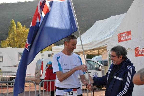 About to shake hands with race organiser, Gerard Cain, after breaking the NZ 500km record